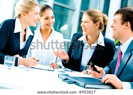 Image of laughing confident people planning a business-strategy - stock photo