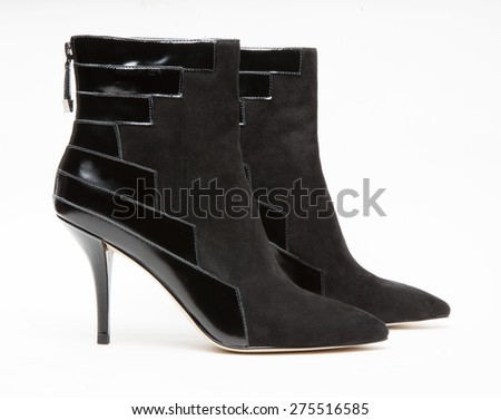 Image of leather ankle boot in white background - stock photo
