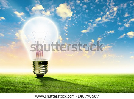 Image of light bulb against nature background. Ecological concept