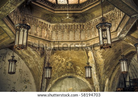 Image of lights hanging from a derelict abandoned church ceiling. - stock photo