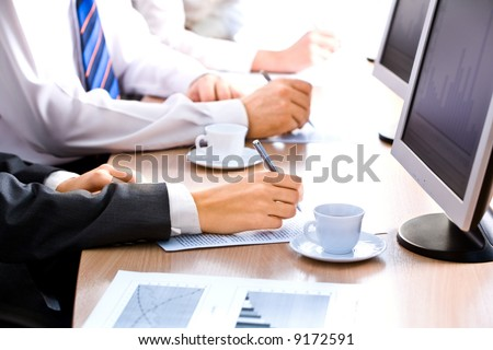 Image of line of human hands lying on the table at business training