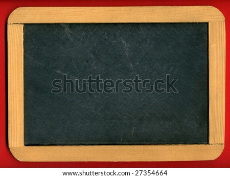 Image of little chalkboard on red background - stock photo