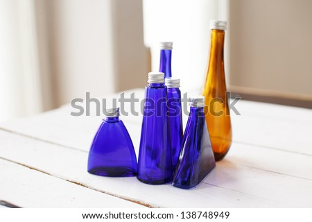 Image of little collection of colored bottles
