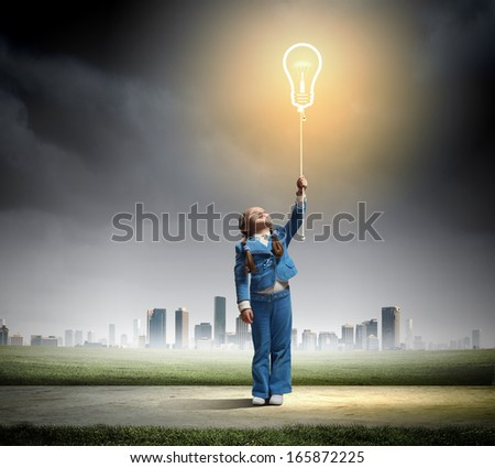 Image of little cute girl holding bulb balloon - stock photo