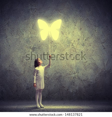 Image of little cute girl holding butterfly balloon - stock photo