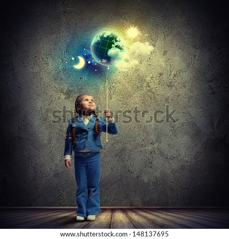 Image of little cute girl with globe - stock photo