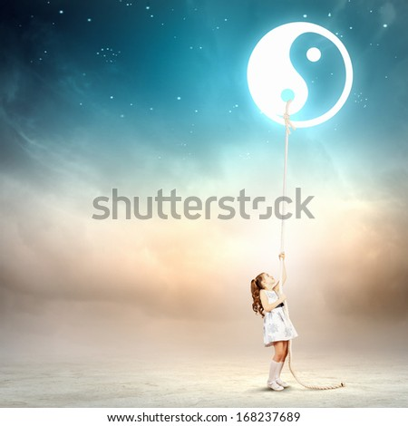 Image of little girl in white dress pulling rope with dao symbol - stock photo