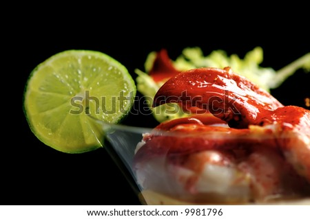 Image of lobster cocktail with sauce and lime garnish - stock photo