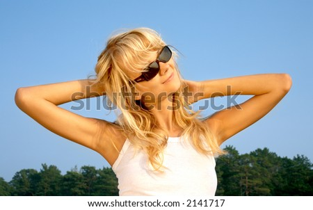image of lovely blond relaxing on the beach - stock photo