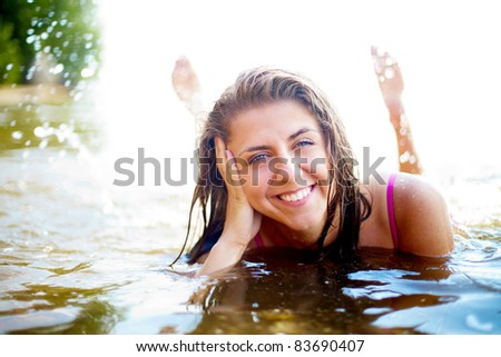 Image of luxurious woman having rest in water at summer - stock photo