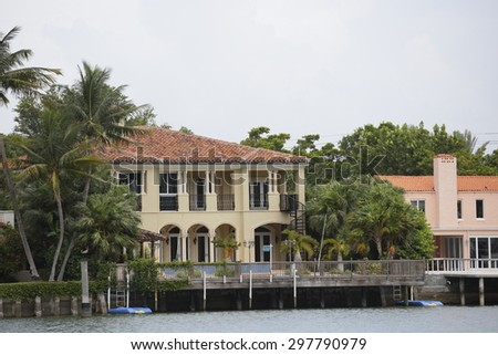Image of luxury mansions on the water - stock photo