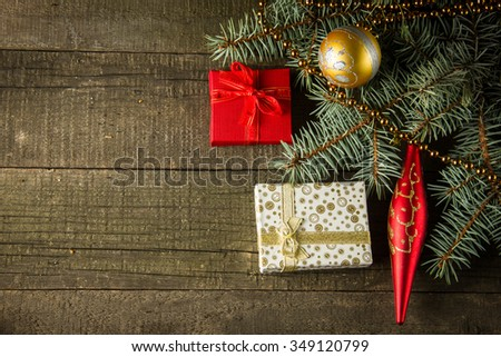 Image of luxury New Year gifts, different present boxes under Christmas tree in holiday eve, Christmastime celebration, home decorated with festive shiny balls, magic x-mas night - stock photo