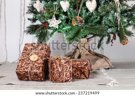 Image of luxury New Year gifts, different present boxes under Christmas tree, magic x-mas night - stock photo