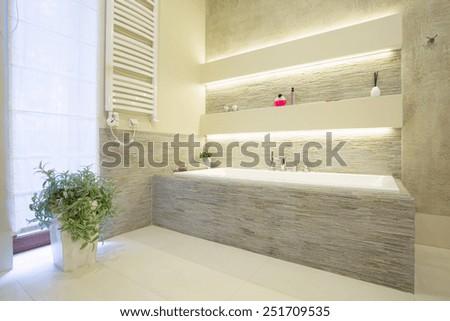 Image of luxury stone bathtub in new washroom - stock photo