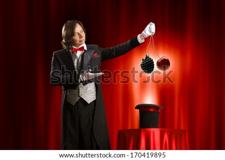 Image of magician showing tricks with hat - stock photo