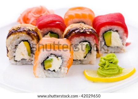 Image of maki sushi rolls served with wasabi