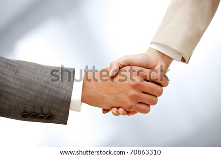 Image of male and female hands shaking - stock photo