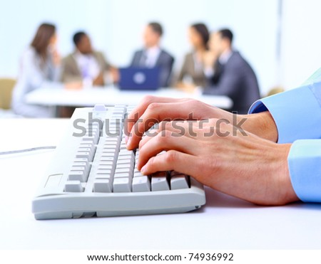 Image of male hands typing on keyboard in a working environment - stock photo