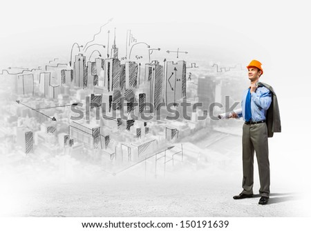 Image of man engineer in helmet with drafts. Construction concept - stock photo