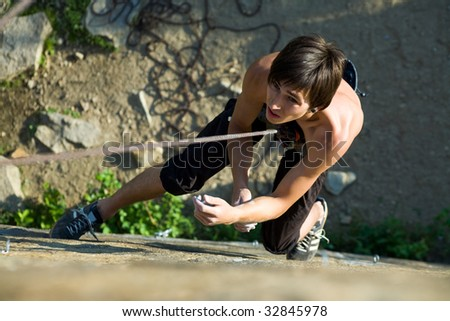 Image of man hanging on the rope - stock photo