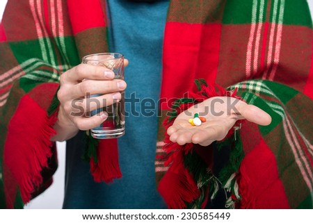 Image of man is taking pills with glass of water. - stock photo