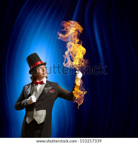 Image of man magician showing trick against color background - stock photo