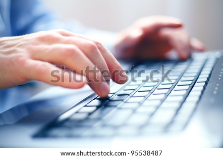 Image of man's hands typing. Selective focus