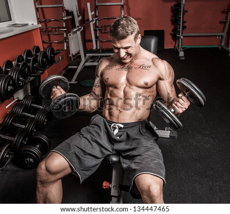 Image of man who is having hard workout - stock photo