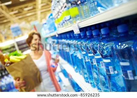 Image of many plastic bottles with water in a shop - stock photo