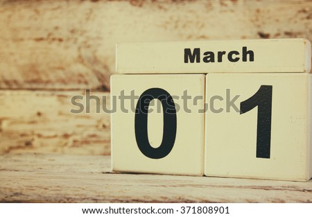 image of March First wooden vintage calendar on white background  - stock photo