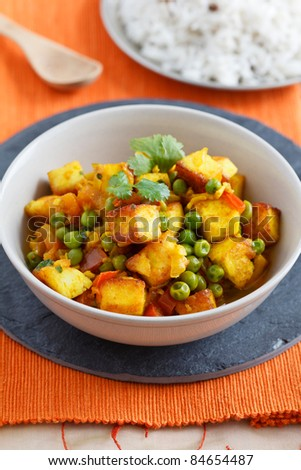 Image of mattar paneer, an Indian vegetarian dish with  paneer and peas in a spicy sauce. - stock photo