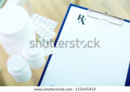 Image of medical document, vitamins and tablets - stock photo