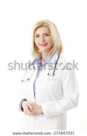 Image of middle age female doctor wearing lab coat and stethoscope while standing against white background.  - stock photo