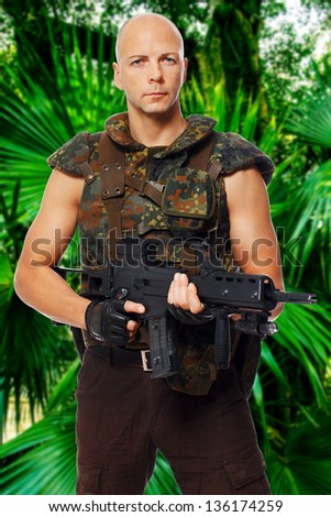 Image of military man who is holding rifle - stock photo
