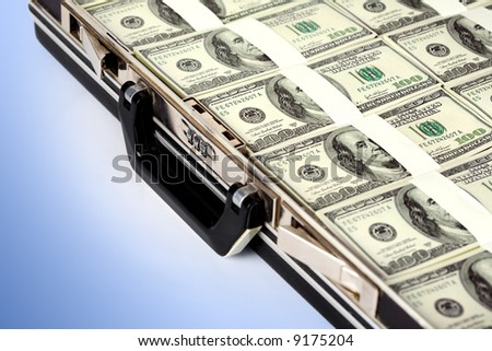 Image of million dollars packing a suitcase on a blue background