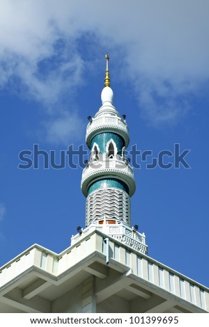 Image of Minaret of the mosque in Thailand with blue sky and cloud. - stock photo