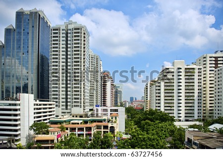 Image of modern buildings on sky background - stock photo