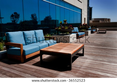 Image of modern outdoor furniture on wooden deck - stock photo