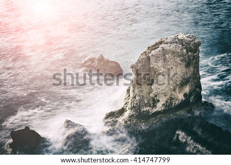 Image of moody landscape at sea with rocks.  - stock photo