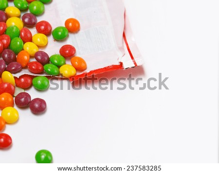 Image of multicolored candies is openned pack - stock photo