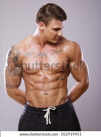 Image of muscle man posing in studio - stock photo