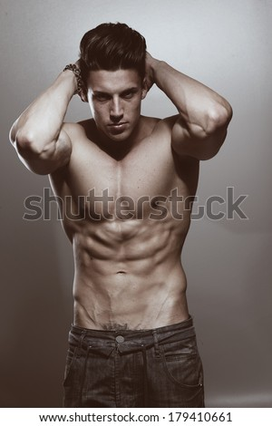 Image of muscle man posing in studio .Fashion colors.