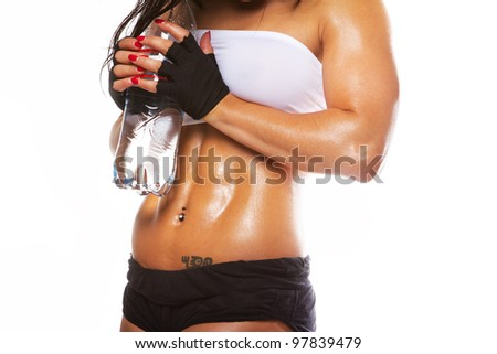 Image of muscle woman with bottle of water - stock photo