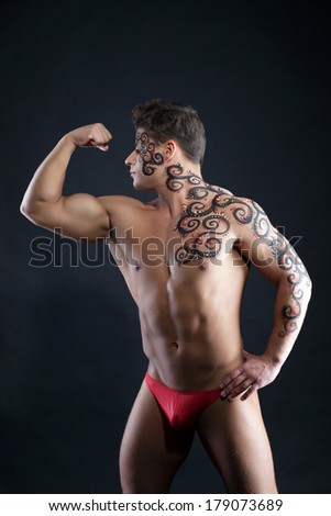 Image of muscular guy posing with pattern on body