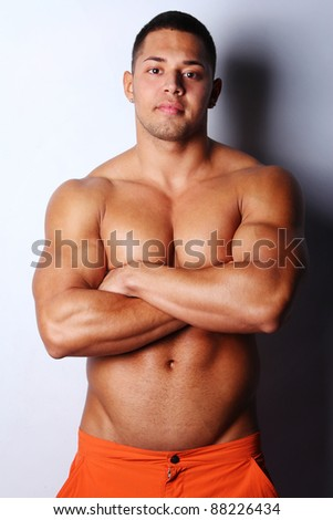 Image of muscular man posing, isolated on white