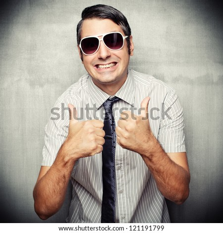 Image of nerd in short sleeved shirt and sunglasses giving a thumbs up - stock photo