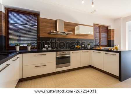 Image of new modern kitchen with wooden floor