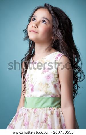 Image of nice little girl posing looking up - stock photo