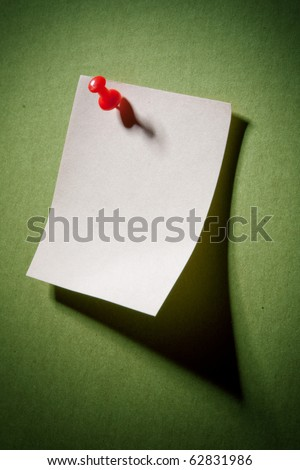 Image of note pad reminder on green cardboard wall - stock photo