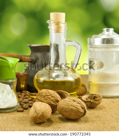 image of nuts, butter, salt shaker, coffee beans, a cup - stock photo